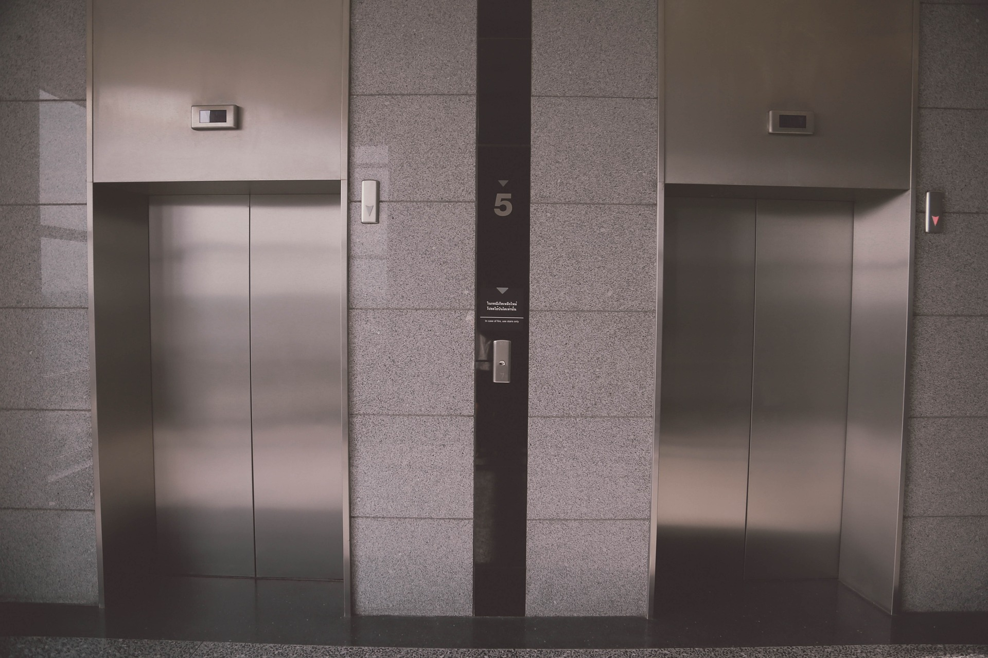 elevator refinishing surface window film chicago